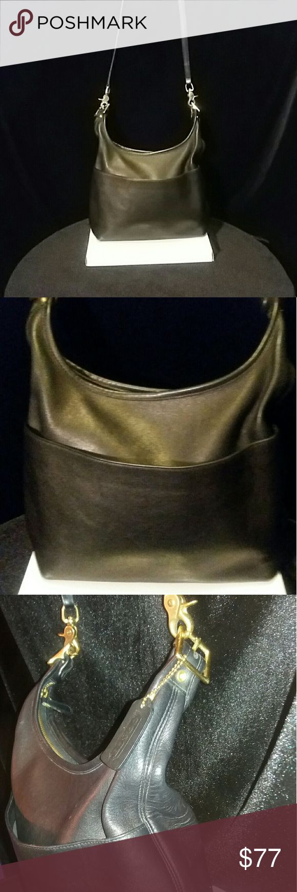 Coach Legacy Leather Handbag 9058 Coach Legacy Leather Handbag Handbag Approximately 10L x 4.5 W inches Drop 27 inches Good Used Condition signs of wear, scuffs, marks , typical leather discoloration all over Emblem/Tag: Yes Bag: No No holds/ NoTrades/ No Personal Emails/ No Modeling Coach Bags