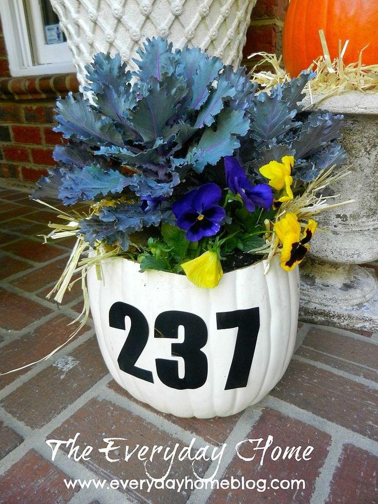 A Pumpkin Planter Doubles as a House Number Sign....