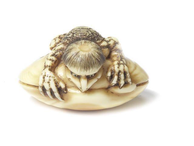 An ivory netsuke of a kappa on a clam By Rensai, late 19th century