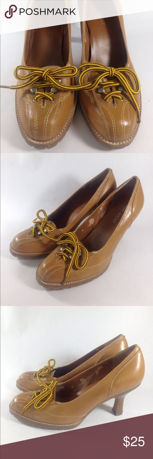 Nine West Brown Leather Pumps Size 8.5 Up for sale is this fun pair of Nine West Round Toe Timberland Style Brown Leather Heels. Super chic lace up details.  Women's Size 8.5   CONDITION: Good Condition! Interior shows wear. Nine West Shoes Heels