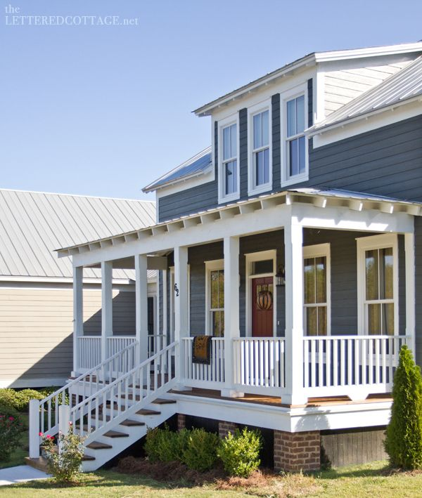 Love the color scheme. Silver metal roof, Gray/Blue Paint & Brown door, with white trim.