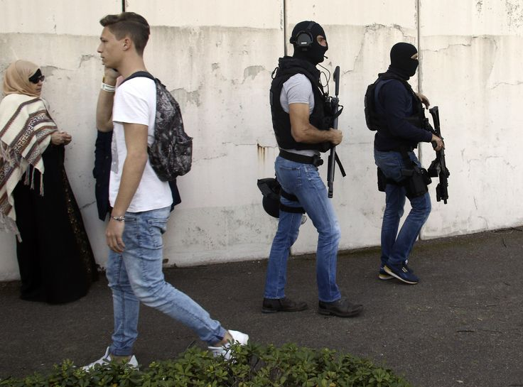 Members of the Research and Intervention Brigade patrol after an attack in a high school in Grasse, southern France, Thu., March 16, 2017. A French high school principal and two others were shot Thursday at their school in southern France, and a 16-year-old student suspected of opening fire on #–, #10, #3, #A, #After, #At, #CBS, #Fire, #France, #High, #In, #Injured, #NEWS, #Opens, #School, #Shot, #Student