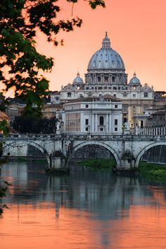 An incredible orange sunset through rainclouds looking towards the Ponte Vitarrio, at the Vatican, Vatican City, Rome, Italy