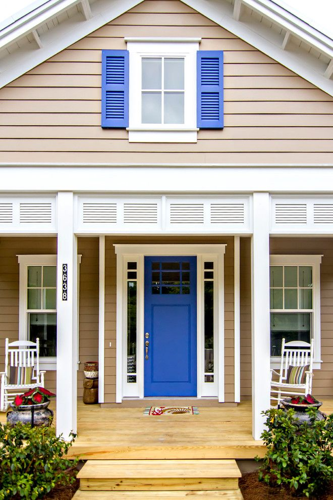 craftsman style front door rocking chairs windows wood floor beach style porch of Elegantly Beautiful Craftsman Style Front Doors to be Amazed By