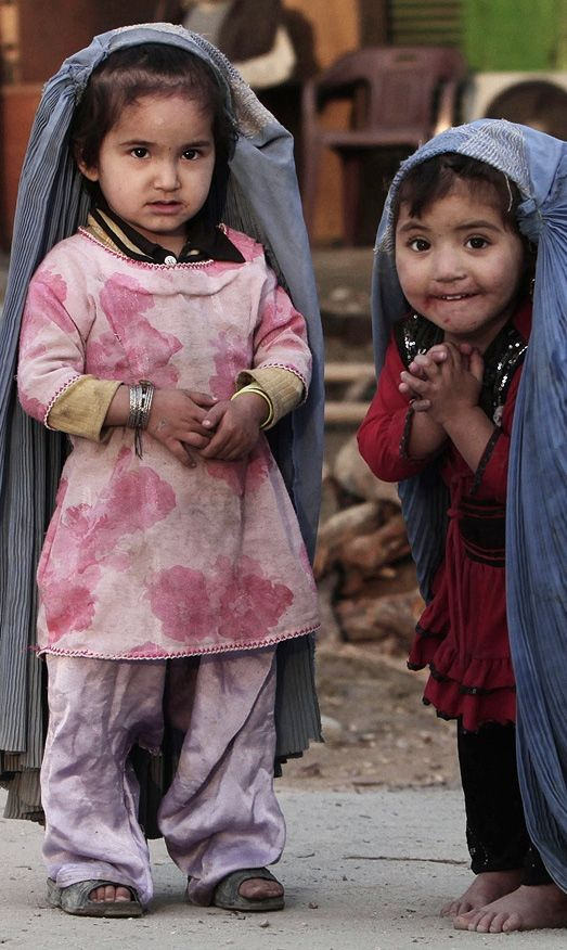 Afganistan girls play house outside.