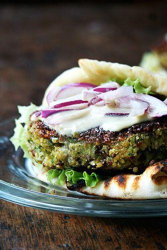chickpea & quinoa veggie burger with tahini sauce and naan