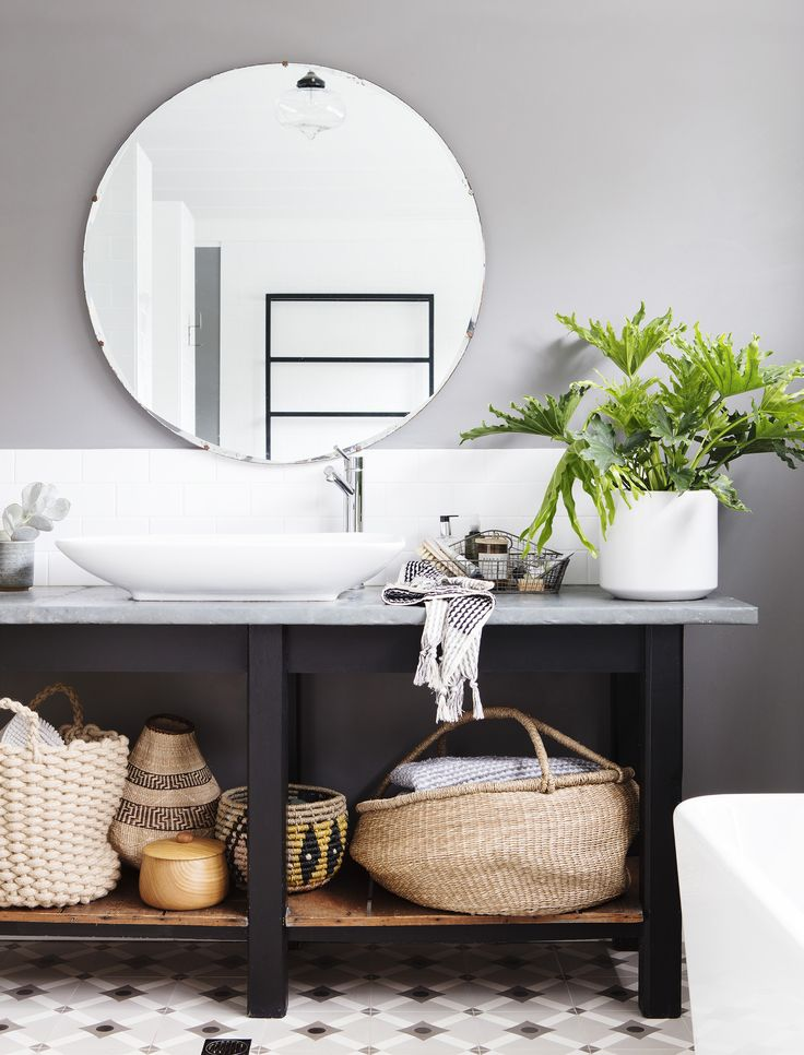 Tiles in a traditional pattern and free-standing console gave this budget friendly bathroom renovation style and character. Photography: Bo Wong | Stylist: Jo Carmichael | Story: Australian House & Garden