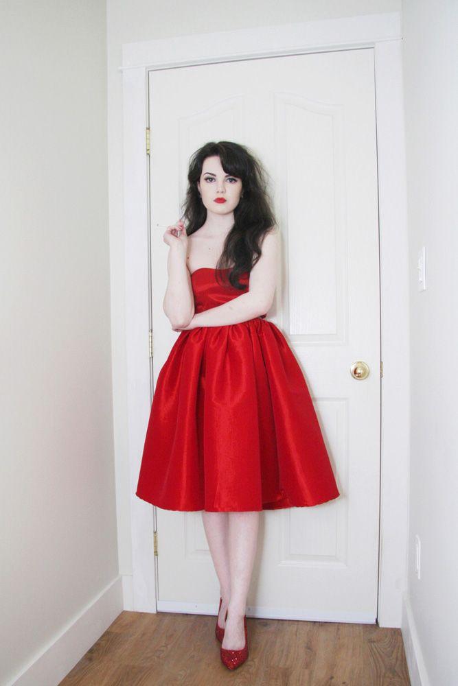 Black pearls white dress red lipstick