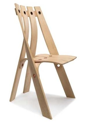 The A chair by David Colwell. This chair is made from fast grown steam bent UK ash with a unique tubular rivet. The rivets are stronger than conventional timber jointing and are suited to steam bending.  The A Chair is from The O Range
