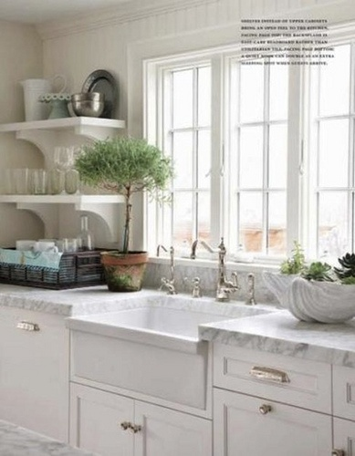 carrara marble counters and farmhouse sink