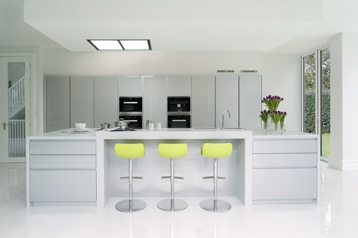 Pedini Dune Metallic Silver Lacquer with Designer White Corian work surfaces. Miele steam combination ovens & microwave. Miele bean-to-cup coffee machine, Miele induction hob and warming drawers. Miele integrated fridge/freezer and Caple ceiling extractor.