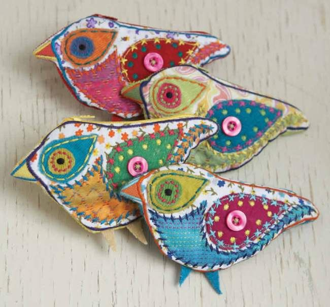 Mixed fibers, embroidered birds. These are sold as change purses but would make great brooches too.