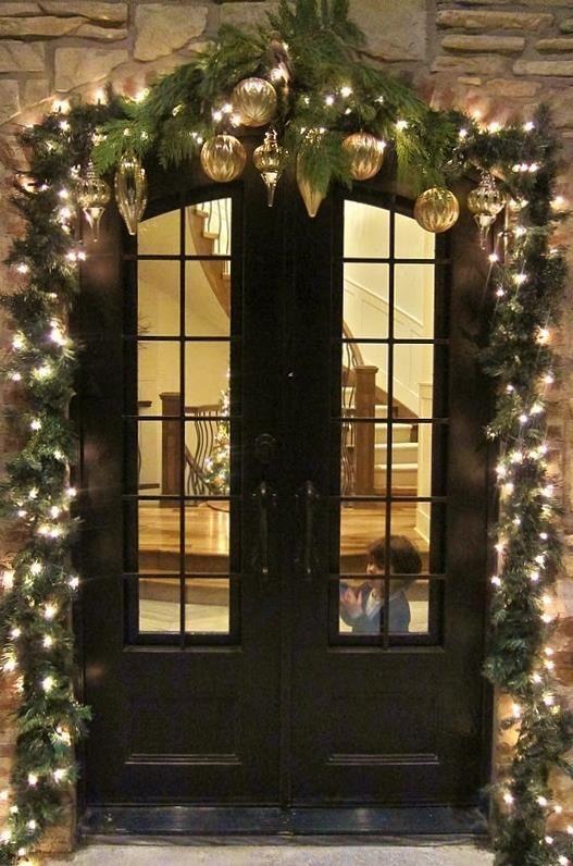 Garland around door frame....so pretty