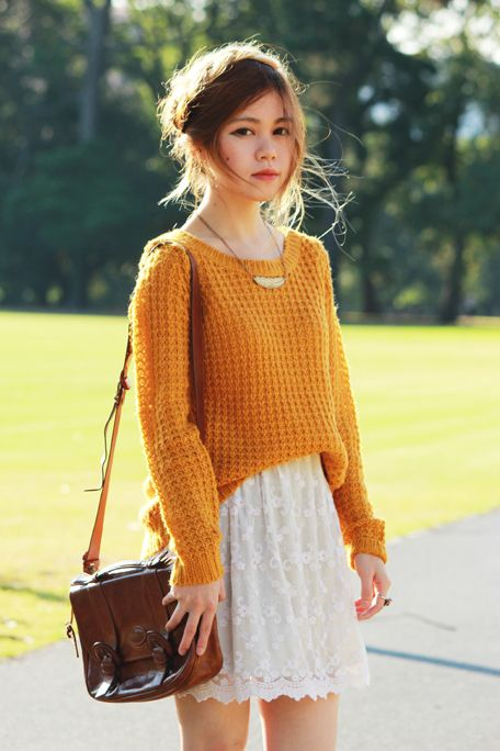 Chunky sweater over dress for spring