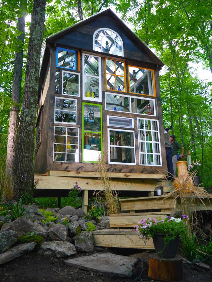"Derek ""Deek"" Diedricksen has dedicated much of his life to creating eccentric dwellings, like this one. Now he's getting some mainstream love. Here, he teamed up with HGTV's ""Tiny House Builders."" Constructed in Lunenburg, Massachusetts, the ""Glass House"" has a facade made entirely of reclaimed windows, with its own distinctive style. Enchanting Glass House Built In Just Four Days 