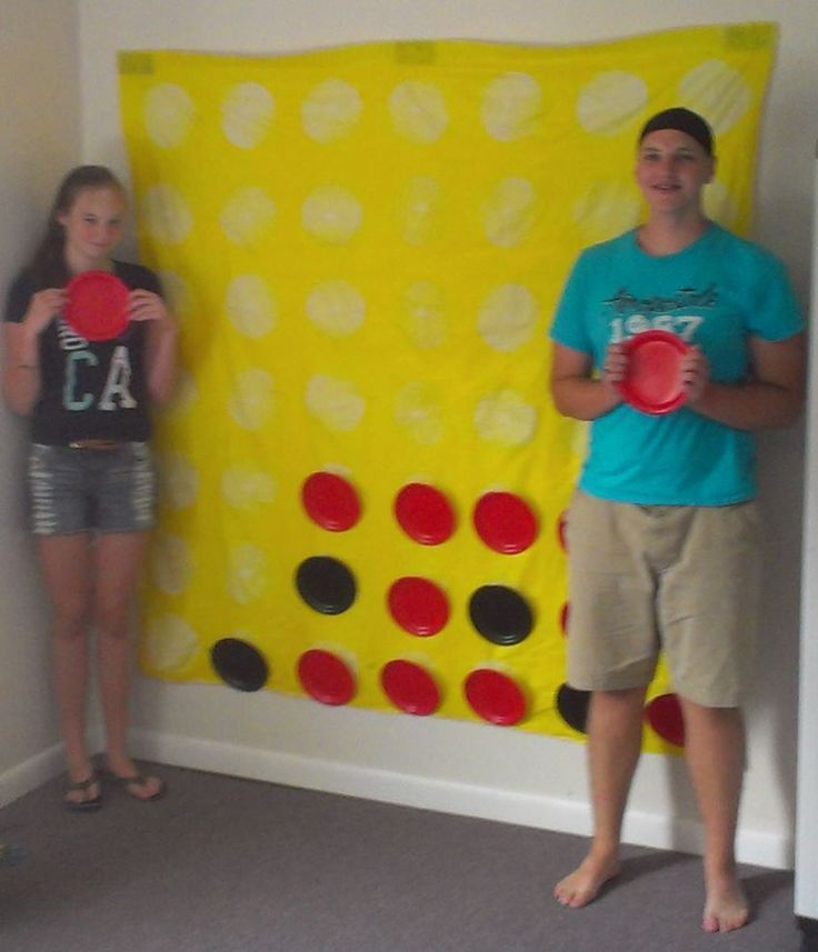 "Giant Connect Four! Take a shower curtain, spray paint it yellow and leave ""holes"" for the game pieces. Grab some plastic plates from the dollar tree and throw on Velcro on the back of the plates and where the holes are, then use Velcro to hang it from th (Kids Wood Crafts Dollar Stores)"