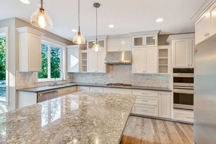 This Breathtaking Kitchen Features A 3x6 Marble Backsplash With A Classic Picture Frame Design