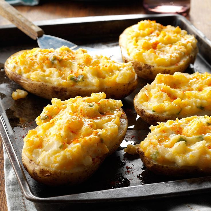 Cheesy Stuffed Baked Potatoes Recipe -These special potatoes are a hit with my whole family, from the smallest grandchild on up. I prepare them up to a week in advance, wrap them well and freeze. Their flavorful filling goes so nicely with juicy ham slices. —Marge Clark, West Lebanon, Indiana