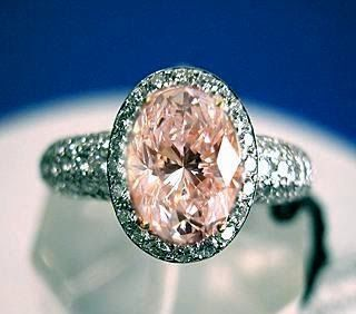Pink Diamond or Saphire oval cut with pave set brilliant rounds - beautiful (Saphire would be a lower cost option)......acc