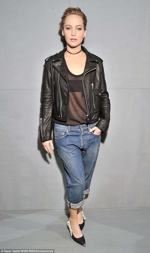 Outfit change: Jennifer later emerged in a sheer top and a leather jacket, channelling roc...
