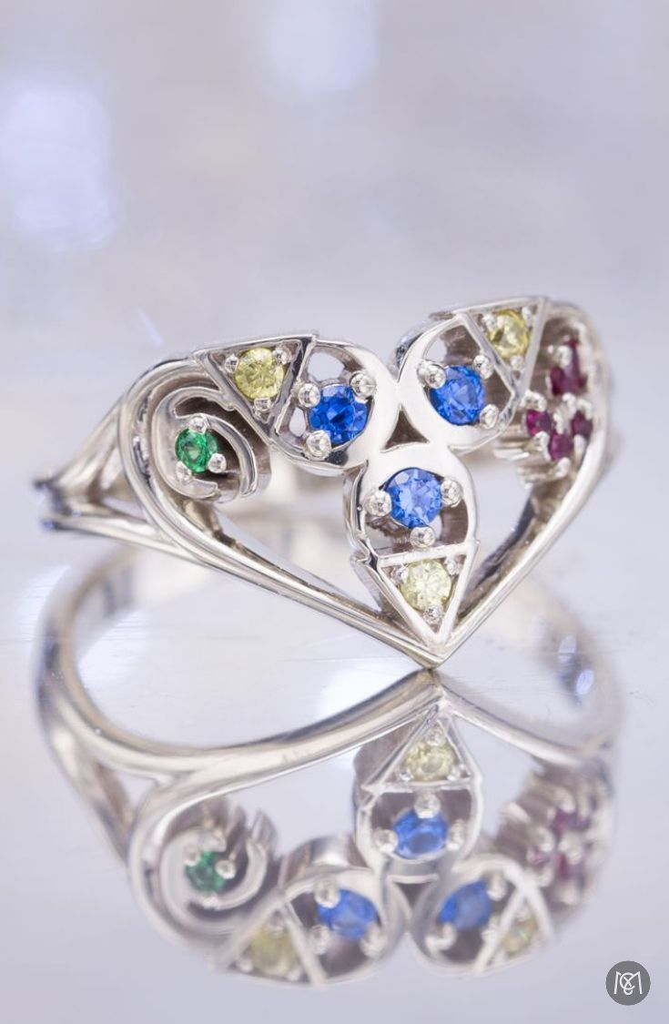 Elegant Curves And Bright Gem Colors Make This A Stunning Engagement Ring But It's The Stylized Blending Of Spiritual Stones From Legend Zelda: Spiritual Stones Zelda Wedding Rings At Websimilar.org