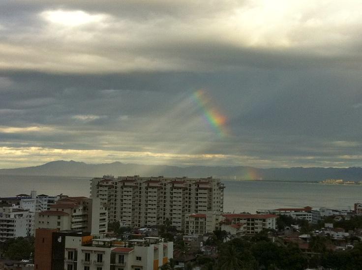 Gorgeous mini rainbow piercing through the sky, just over the Molino De Agua building in Zona Romantica, Puerto Vallarta
