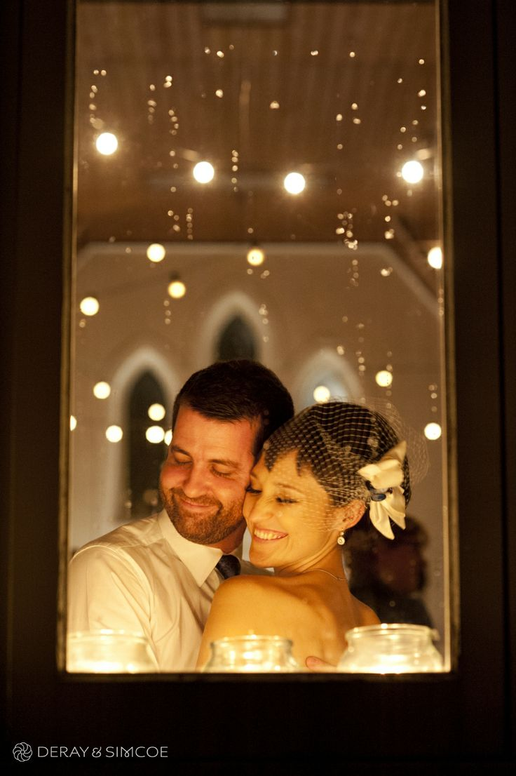 Magical twinkling lights and rain drops on the window. Romantic bride and groom. Vintage wedding reception styling, ideas and inspiration.  Reception Venue: St Paul's, Beaconsfield  Photography by DeRay & Simcoe