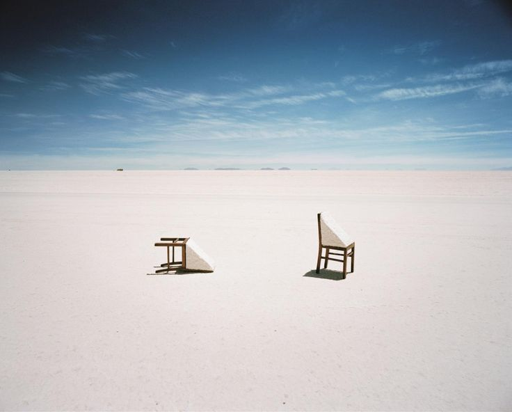 Scarlett Hooft Graafland - I really like the graphic nature of this image. I think the packed sand on both chairs is somewhat humorous and adds a little extra to this pretty minimalist photo.  One of the things that makes me admire Scarlett Hooft Graafland's photos the most are her intense clear skies.  The blue is always some of the most beautiful tones I have every seen.  I think I saw this was taken in Bolivia, so I'm wondering if this is salt, and not sand?