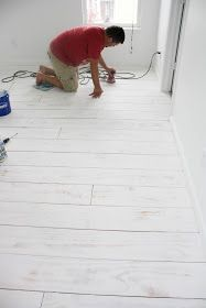 white wash DIY PLANKED FLOORS with 1part primer to 3 parts primer & sand afterward