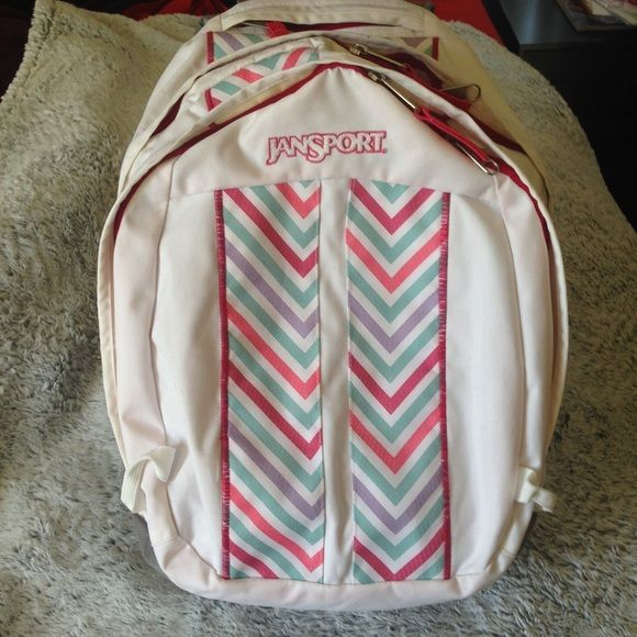 White and pink jansport backpack Large backpack in great condition. Used for school and carried lots of big books comfortably. Padded straps and back. Jansport Bags Backpacks