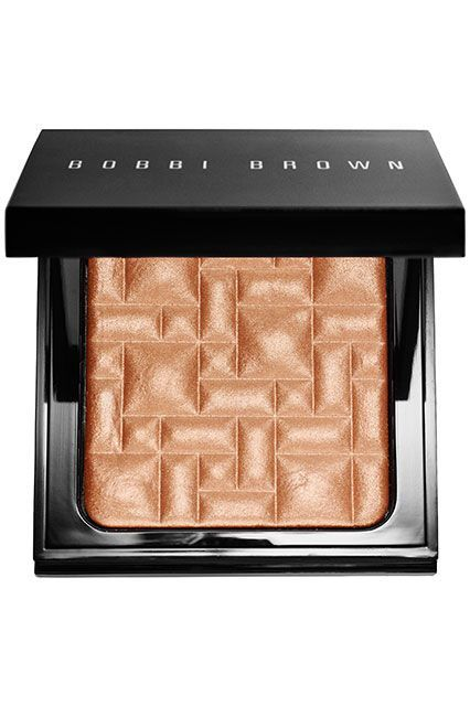 Bobbi Brown's new highlighting powder might look a little intimidating, but Barose has a trick for keeping it subtle: Apply it before you sweep on powder foundation. This will give you a pretty sheen without overpowering your face. #refinery29 http://www.refinery29.com/highlighters-makeup-for-dark-skin#slide-7