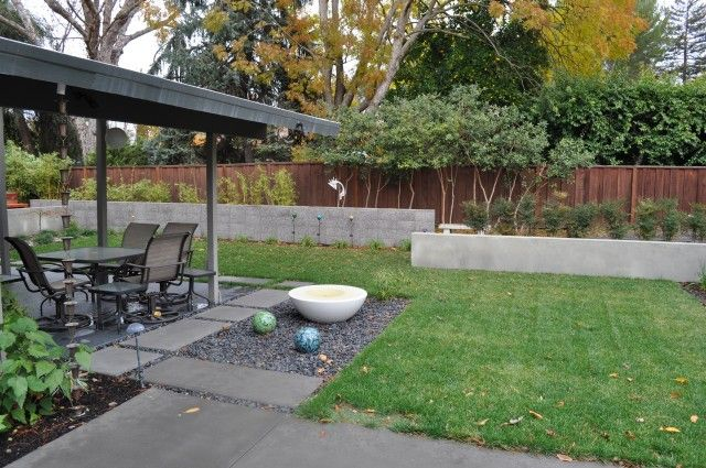 like the rock garden off the patio...could be a cool place to put a fire pit.  also love the concrete pavers