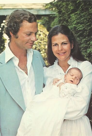 The Three Princesses:  King Carl Gustaf and Queen Silvia holding Crown Princess Victoria