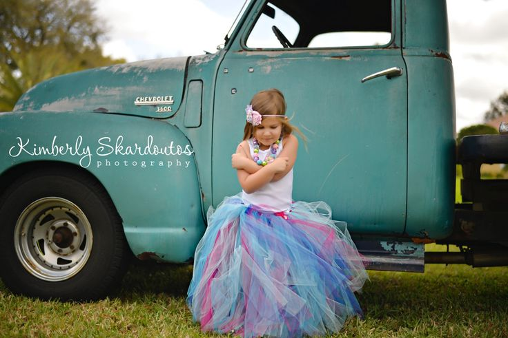 Multi colored floor length flower girl skirt with shabby chic flowers and satin ribbon tie.