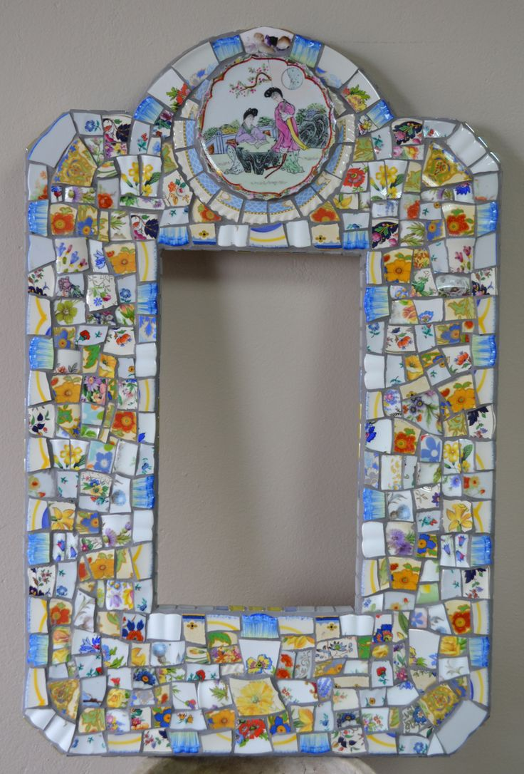 Mosaic mirror frame made with broken china. Wasn't sure about this one but it looks good