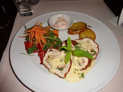 stuffed chicken breast with Cretan smoked pork, fresh herbs, topped with a white wine cream sauce