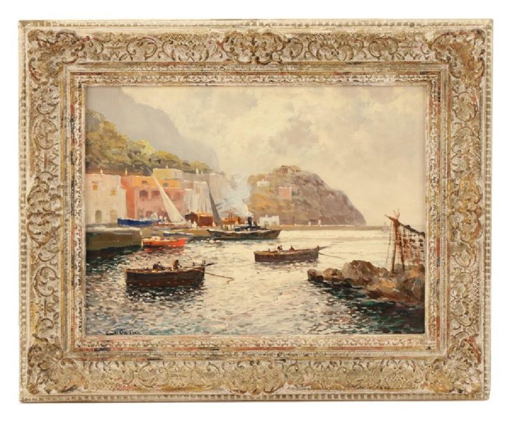 """Guido Odierna (Italian, 1913-1991), """"View of Capri"""", oil on canvas, signed lower right. Coastal harbor painting depicting the island of Capri in the Bay of Naples with rugged cliffs in background behind pastel buildings, boats in water glimmering from the light above, clouds overhead. Label on verso of frame from Grable's Galleries in Oak Park, Illinois, marked on back of stretcher with artist materials manufacturer M. Grumbacher, verso of canvas with stamp noting copyright of artist. Framed…"""