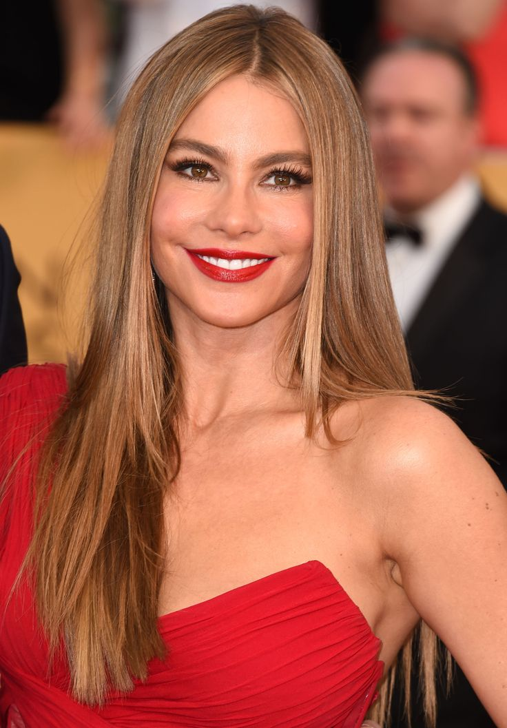 While her sexy waves are gorgeous, Sofia's sleeker straight hairdo proves that long hair is always versatile.  - GoodHousekeeping.com