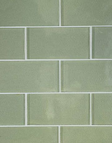 Glacier Bay glass tiles in glossy finish are from Waterworks.Subway Tile