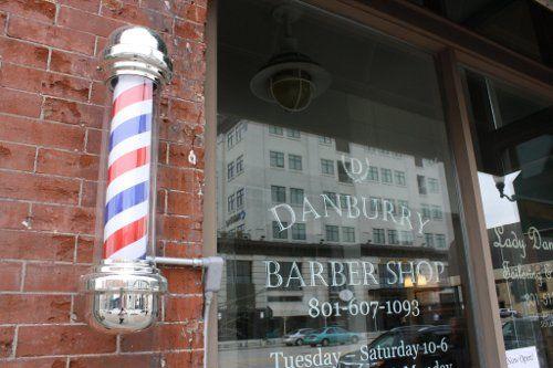 danburry barbershop storefront old barber pole