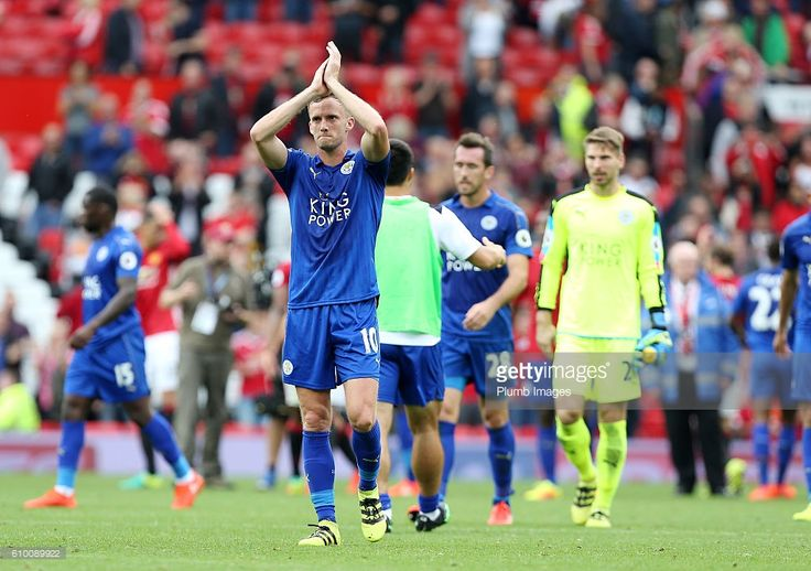 Andy King of Leicester City applauds the travelling fans after the Premier League match between Manchester United and Leicester City at Old Trafford on September 24th, 2016 in Manchester, United Kingdom.