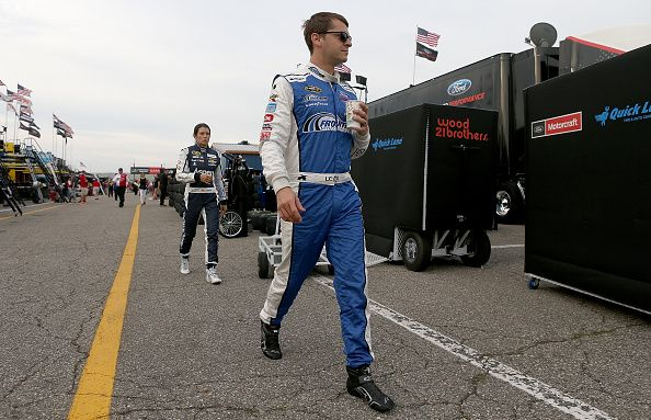 Landon Cassill driver of the MDS Transport Ford and Danica Patrick driver of the…