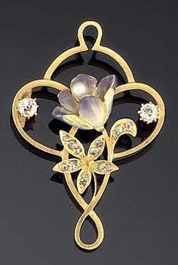 AN ART NOUVEAU GOLD, DIAMOND AND ENAMEL BROOCH. Of openwork cartouche design wit...