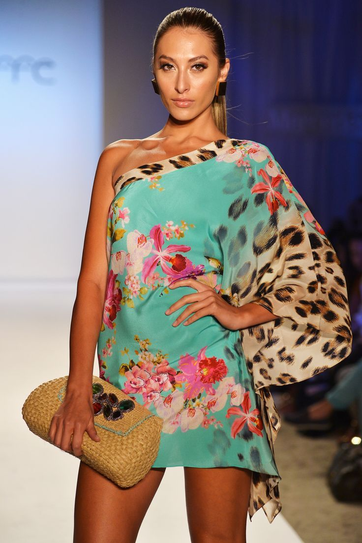 CAFFE: Flowers and Leopard Silk one shoulder mini dress. Perfect for any after sunset event. SHOP AT www.rosatocollections.com www.facebook.com/rosatocollectionsonline