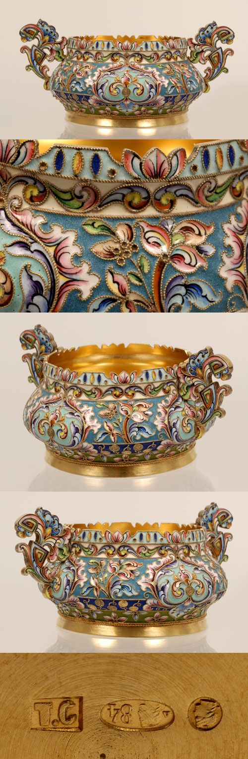 A Russian silver gilt and shaded cloisonne enamel bowl, Moscow, circa 1908-1917. The bombe shape circular bowl with scrolling pierced and shaped handles and rim completely worked in a flowing multi-color floral and foliate motif with scrolling arabesque cartouches.