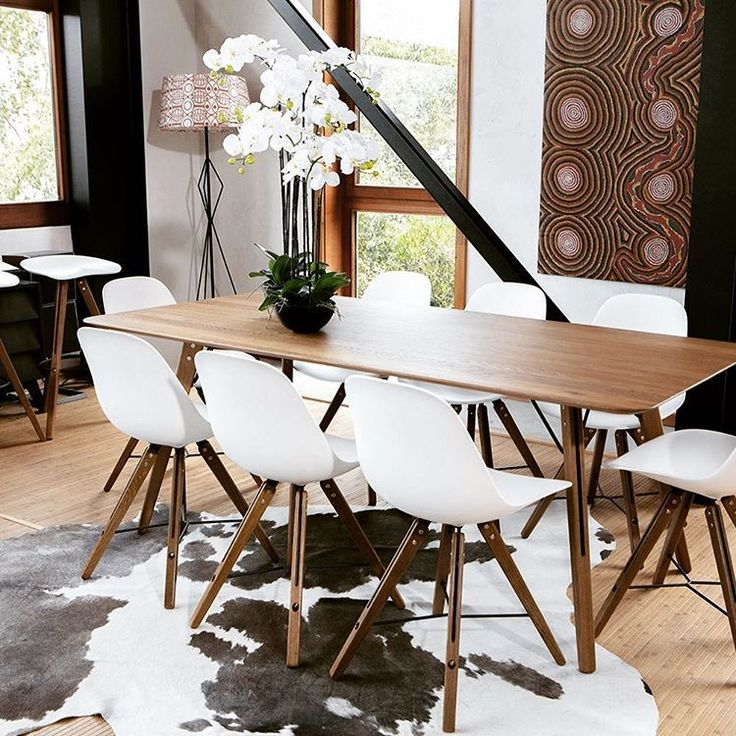 Theo Dining Table screaming #style matched with the Shell dining chairs on a stunning cowhide. #accessories #design #interiordesign