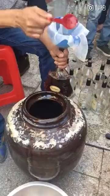 Just some dudes making fake bottles of Hennessy XO in their backyard.
