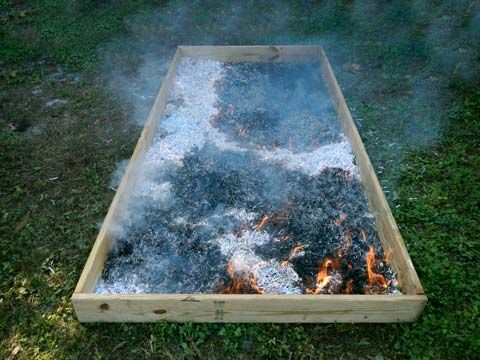 "Fired Up - Gardener says she fills her raised beds with 3-4"" of paper shred, then quickly burns it to kill the weeds.  She said it did not leave a mark on the wood. I would top with cardboard afterwards for extra weed protection,"