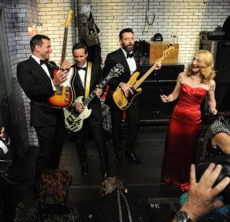 Bradley Cooper, Hugh Jackman, Alessandro Nivola and Patricia Clarkson take part in a backstage bit at the show.