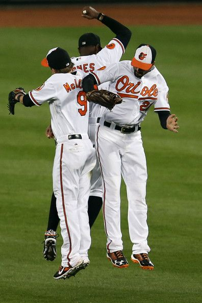 Nate McLouth #9, Adam Jones #10, and Nick Markakis #21 of the Baltimore Orioles celebrate after the Orioles defeated the Chicago White Sox 3 -1 at Oriole Park at Camden Yards on September 5, 2013 in Baltimore, Maryland.